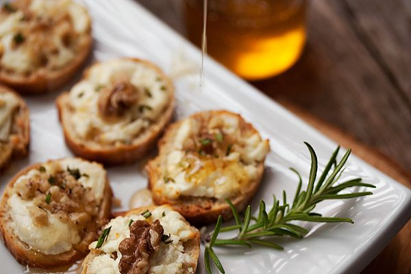 Goat Cheese Crostini with Walnuts and Honey