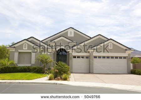 Stock photo gray stucco two story modern home with three for Stucco modular homes