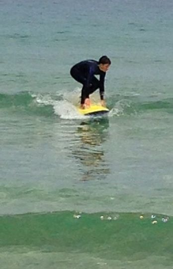 Me Riding those huge waves in the summer in Cornwall!