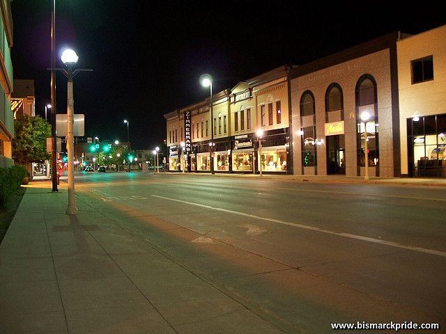 Nightview Of Main Avnue In Downtown Bismarck, North Dakota. Webb Brothers  Building In Center, Housing Zimmermanu0027s Furniture.