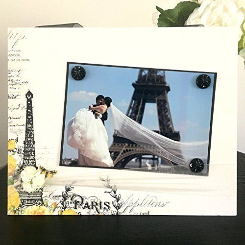 "Meet Me In Paris Wedding Eiffel Tower engagement honeymoon anniversary trip travel bridal shower mom mothers day gift handmade magnetic picture frame holds 5"" x 7"" photo 9"" x 11"" size. My frames are magnetic backed, covered with beautiful paper, and come with 3 embellished magnets. All frames are 9 x 11 and have a velvet easel back for free standing display or can be hung by a beautiful attached ribbon. Each frame is great for 1 to 3 pictures, notes, or recipes. You can put your pictures..."