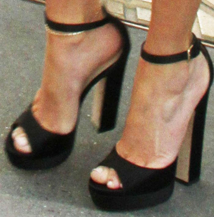 a98303c777 J.Lo wore her first pair of Jimmy Choo platform shoes for the day ...