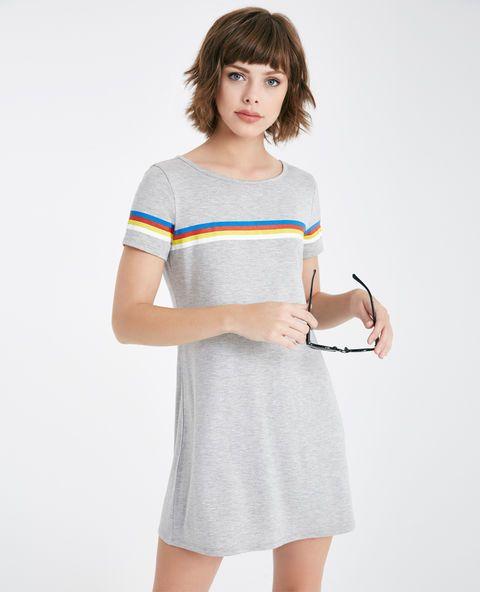 """<p>This cute and casual T-shirt dress features a super soft knit body, a rainbow stripe across the shoulders, a shirttail hem, and a relaxed fit.</p>  <p>Model wears a size small.</p>  <ul> <li>Scoop Neckline</li> <li>Short Sleeves</li> <li>Pull-on Construction</li> <li>Unlined</li> <li>31"""" From Shoulder to Hem</li> <li>Rayon / Spandex</li> <li>Hand Wash</li> <li>USA</li> </ul>"""