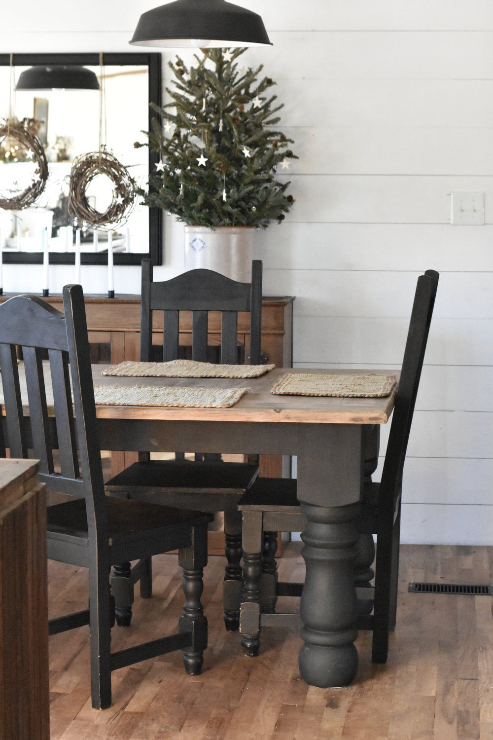 Rustic Farmhouse Christmas Dining Room Table And Chairs Painted Black Paired With Wood Floors