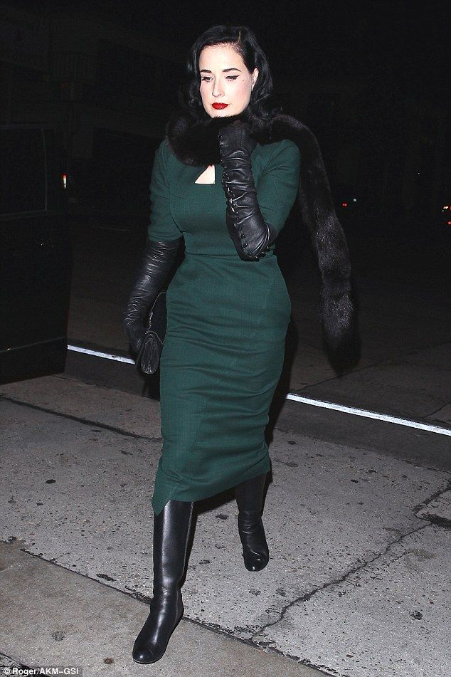 24f6e211c2e Dita Von Teese looks gorgeous in green as she braves the wet weather ...
