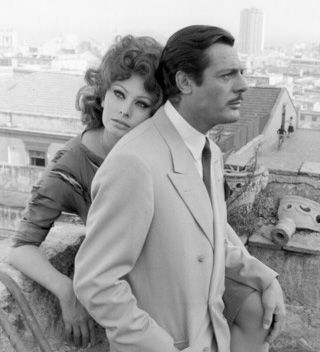 Between his never-ending marriage to Flora Carabella, lengthy affair with Faye Dunaway, and child with Catherine Deneuve, Italian actor and heartthrob Marcello Mastroianni knew a thing or two about complicated relationship statuses.