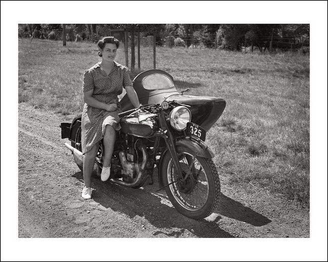 Vera Sullivan with the family Royal Enfield motorcycle and sidecar during the 1940's. https://www.flickr.com/photos/69559277@N04/7862139092/in/album-72157627999270413/