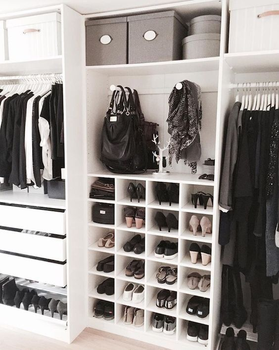 Incorporate drawers, bins, and shelving units into your walk-in closet to create a more organized and stylish closet!