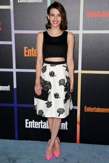 Actress Emma Roberts chose a cropped Houghton top, a floral Tanya Taylor skirt and pink Casadei pumps for Entertainment Weekly's Annual Comic Con Celebration.
