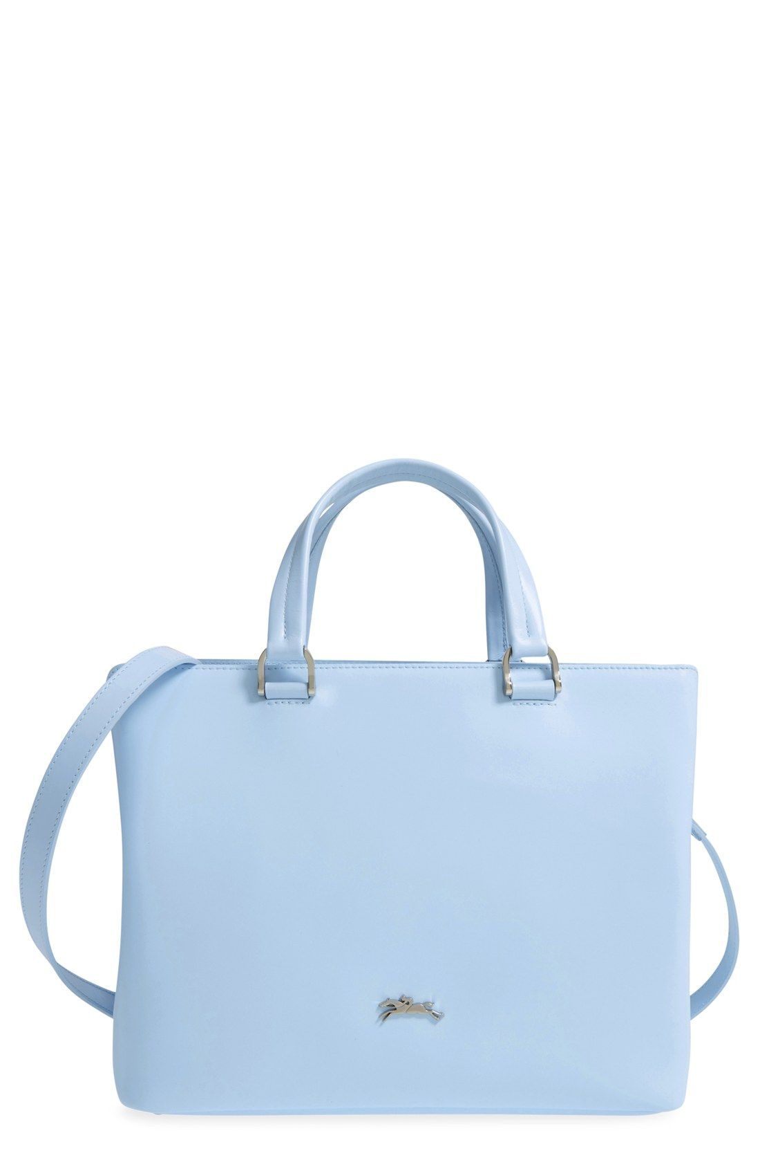 a7aec94cbd08 Such a pretty color! This tote from Longchamp boasts pale blue leather