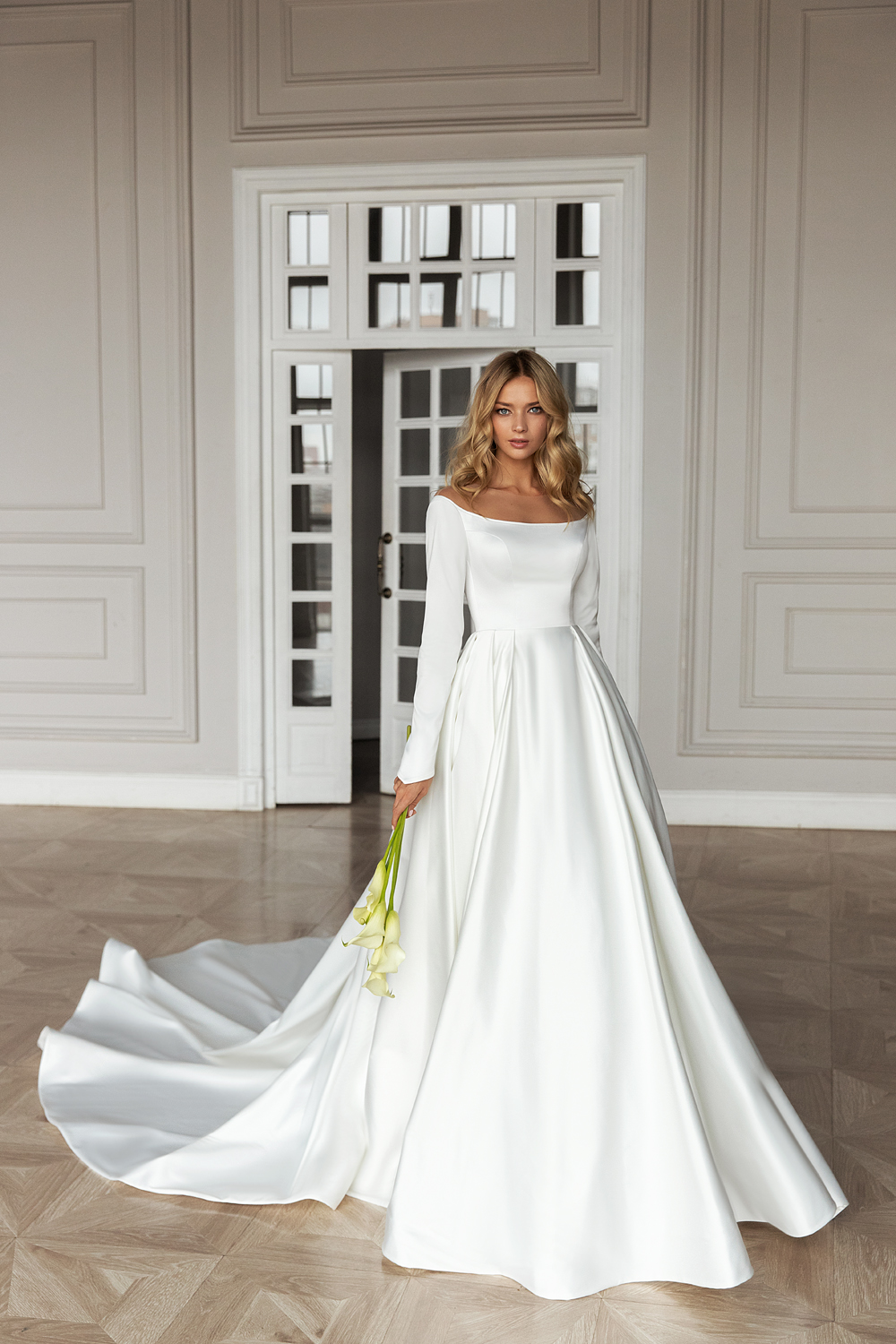 A Delicate And Tender Wedding Gown With A Deep Boat Neckline The Closed A Line Dress Is Made Of Wedding Dress Sleeves Modern Wedding Gown Wedding Dresses Lace [ 1500 x 1000 Pixel ]