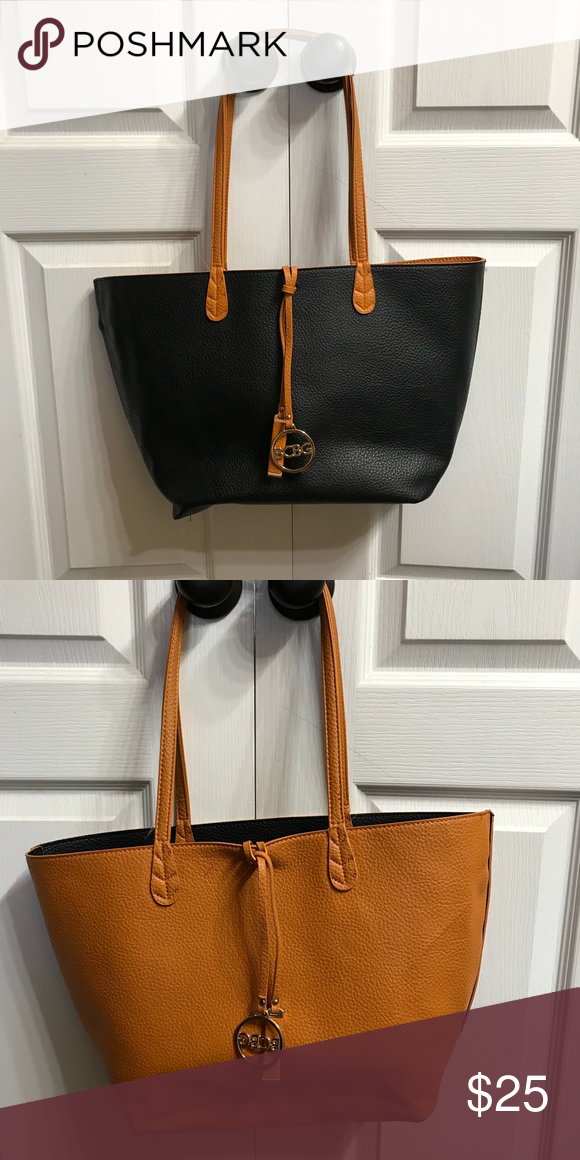 248981c9ff42 Bcbg Paris Convertible reversible handbag Orange/black reversible ...