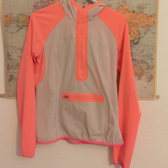 9003c7ad6bf07 Lululemon Stash and Dash pullover Lululemon stash and dash pullover in pop  orange dune. Great condition. Size 4 lululemon athletica Tops Tees - Long  Sleeve