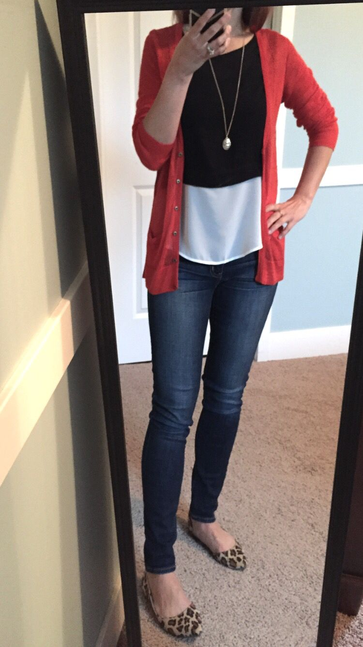 Red-orange cardigan, black and white color block top, skinny jeans ...