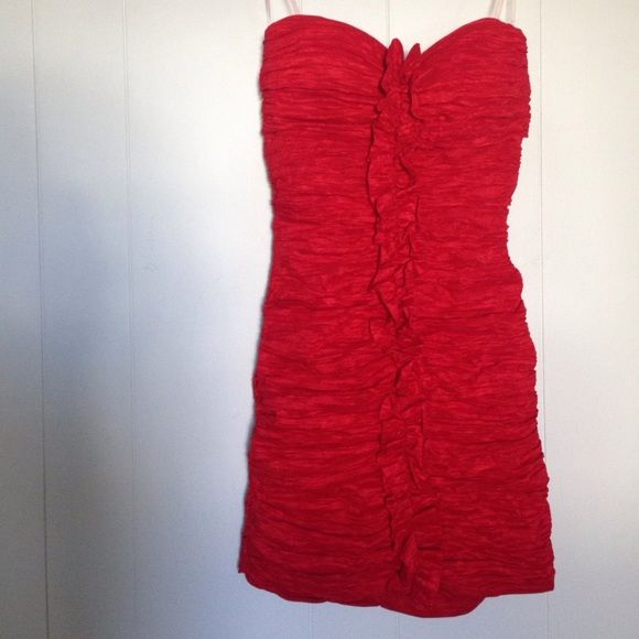 Red Prom Dress Bought for a masquerade ball, wore it once. Bodycon red dress with Ruffles up the front, strapless and short. Fits really well on any body shape. Invisible zipper up the back. Michelle Dresses