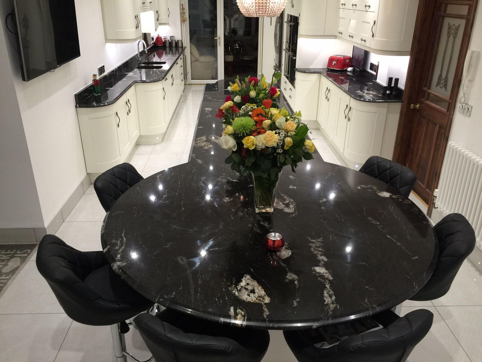 Broad Oak Porcelain Shaker Kitchen with curved doors