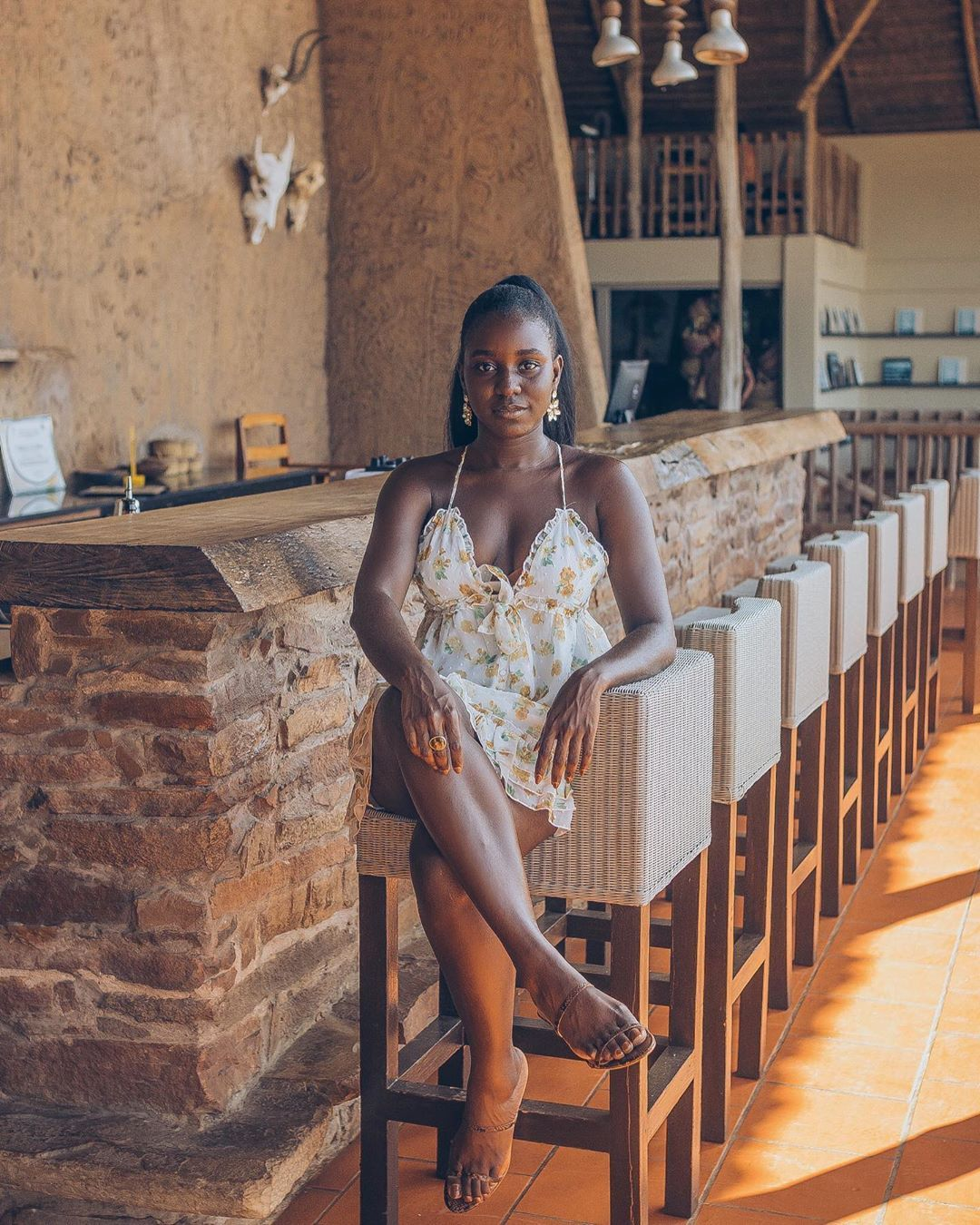 "Ghanaian Lifestyle  Blogger on Instagram: ""Sitting pretty and blending into the @zainalodge bar. I loved wearing this dress from @majorelle_collection via @revolve , it's the perfect…"" #darkskingirls"