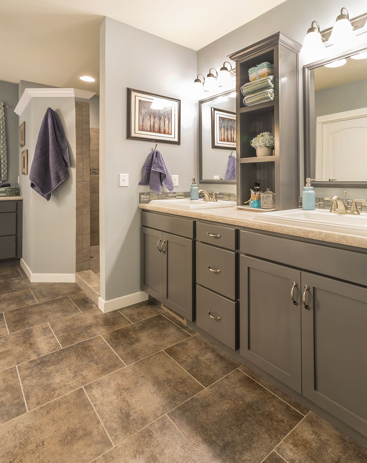 This Gray Vanity And Warm And Inviting In This Master Bath Shadesofgray Vanity Cabinetry Col Modular Homes Modular Home Manufacturers Custom Modular Homes