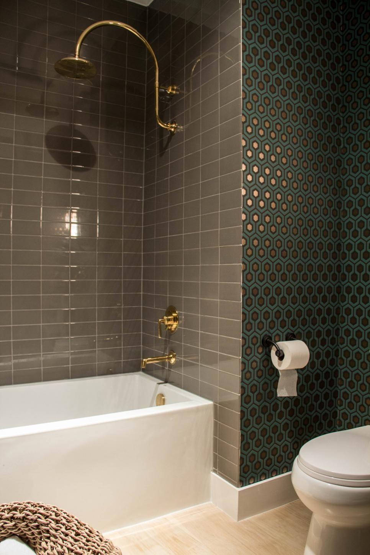 Neutral ceramic shower tiles provide a striking,