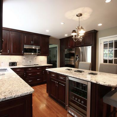 Kitchen Dark Brown Cabinets With White Granite Top Design
