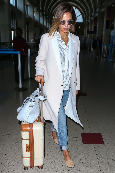 Who: Jessica Alba What: A Striped Button Down Why: The mogul-in-the-making took to the airport in style—pairing a classic trench with a menswear inspired button down that will take anyone miles—whether in the air, or on the ground. Get the look now: Madewell shirt, $188, madewell.com.