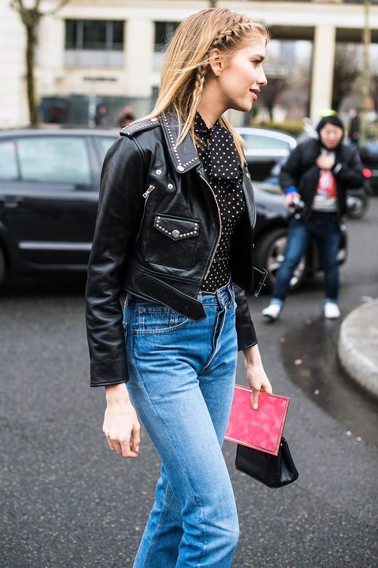 Elena Perminova in a studded black leather jacket with a polka dot blouse and vintage denim.
