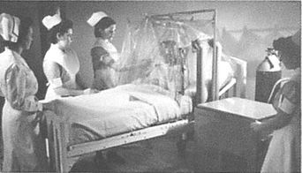 Nurses learn how to care for a patient in an oxygen tent. & Nurses learn how to care for a patient in an oxygen tent. | Breath ...