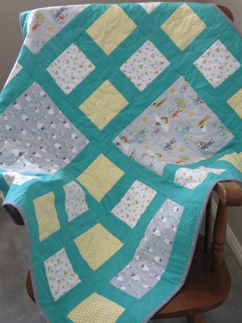 Bunny sheep chicks and flowers baby girl quilt