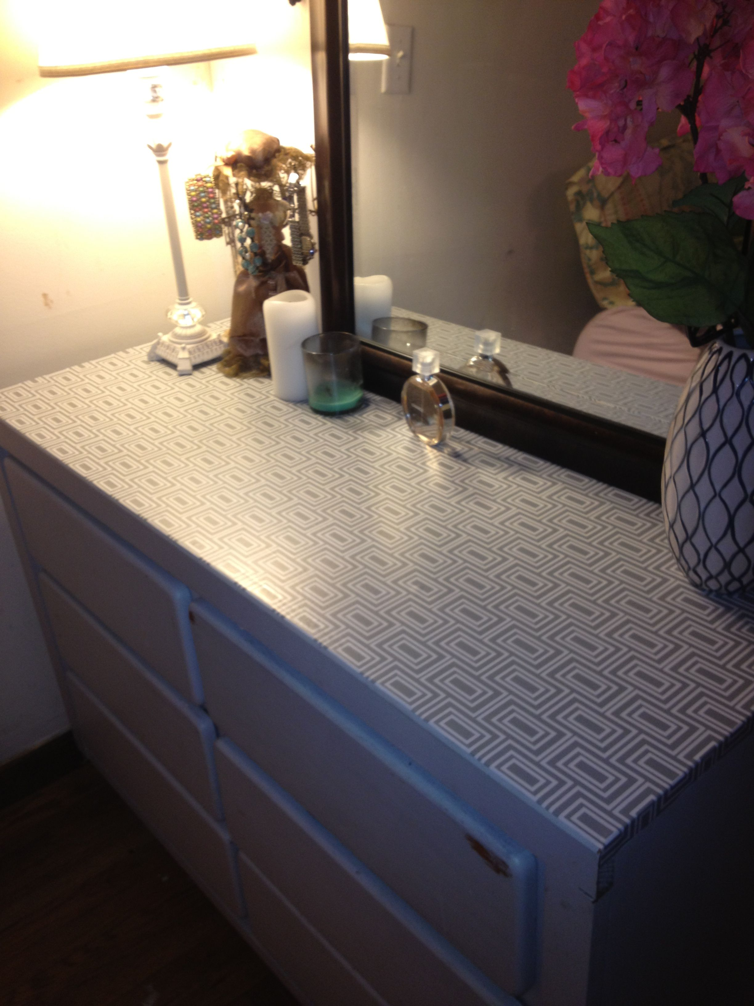 I did this myself Drawer adhesive paper on the top of an old