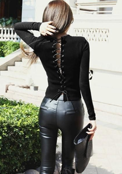 Back View Of Girl In Black Lace-Up Back Top And Leather