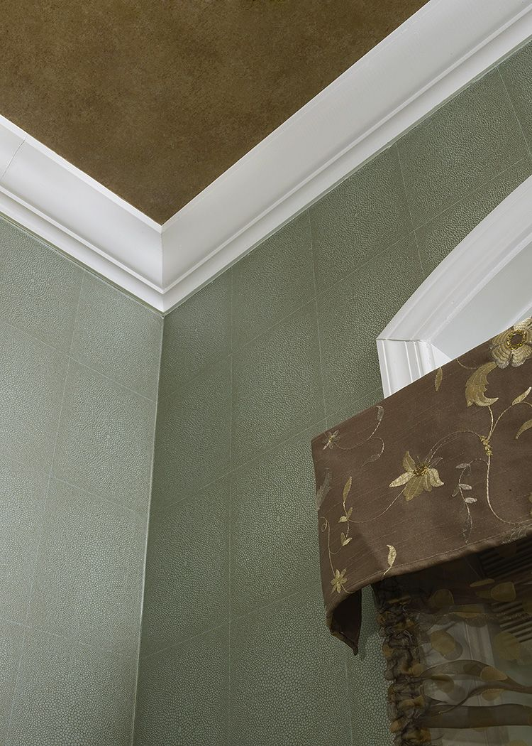 The fabulous wallcovering on this ceiling adds great texture and warth to this space....