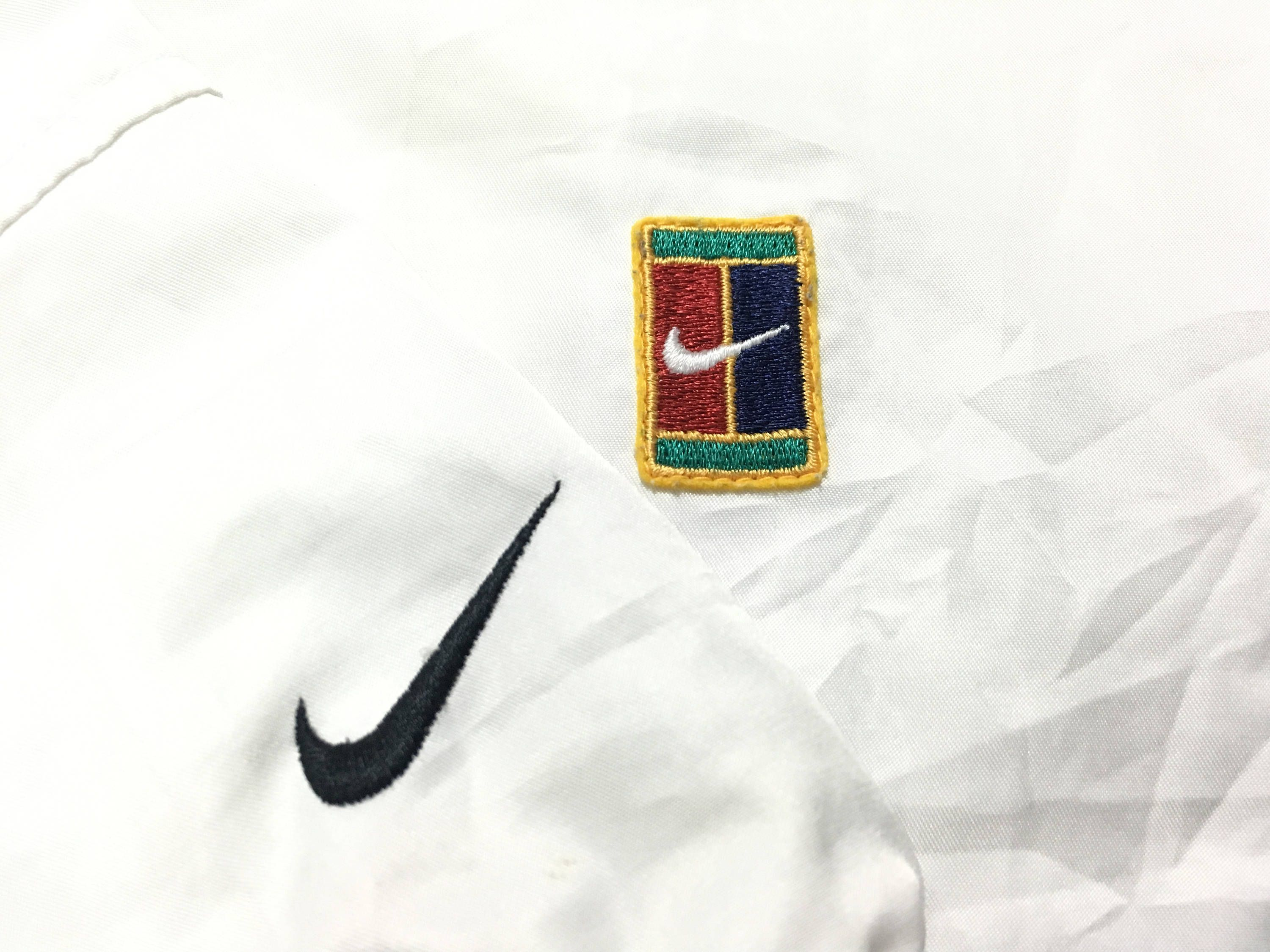 48e3ebe8 Vintage Nike jacket windbreaker tennis court swoosh logo Size L Good  condition by AlivevintageShop on Etsy
