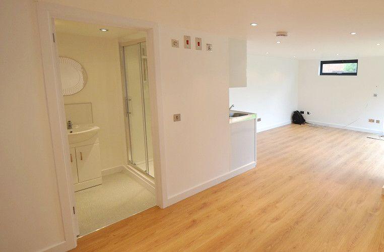 Stylish laminate flooring, and spacious shower facilities ...