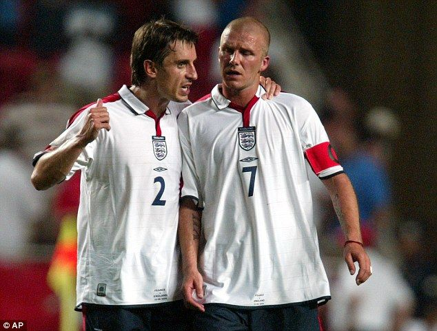 Gary Neville with his Manchester United colleague David Beckham after losing to France