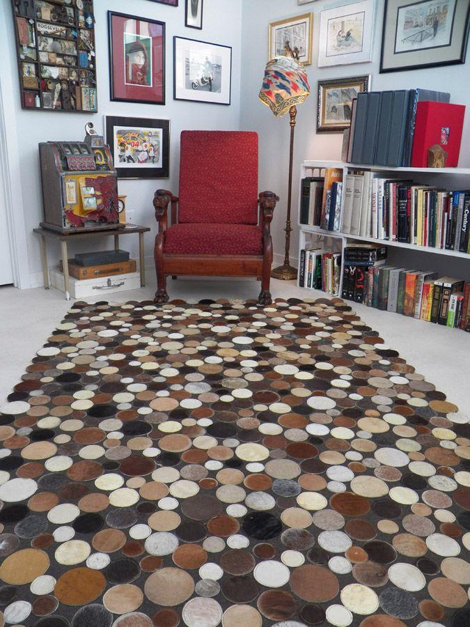 Rug made of 400-500 cowhide circles of various shades.