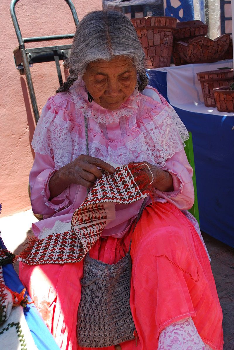 Otomi women embroidering at her stand in Tequisquiapan, Queretaro,