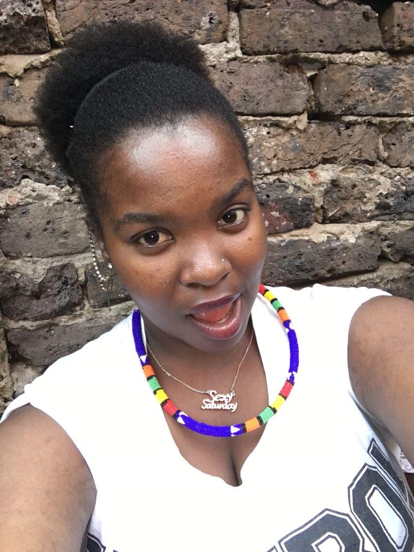 my afro journey afro bun on my birthday rocking zulu beads