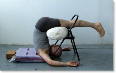 half plough pose on chair ardha halasana  plow pose yoga