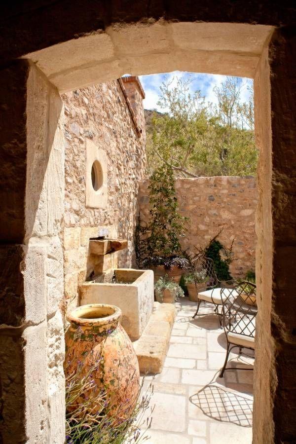 Patio design ideas stone wall terracotta pots metal chairs coffee ...
