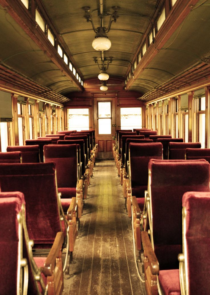 Interior Of A Vintage Train With Rich Red Seats And