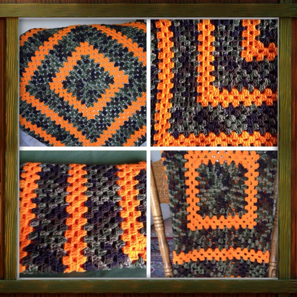 Crochet granny square baby blanket. Camo and hunters orange. It's just one big granny square. This blanket was super easy to make and it grows really fast.