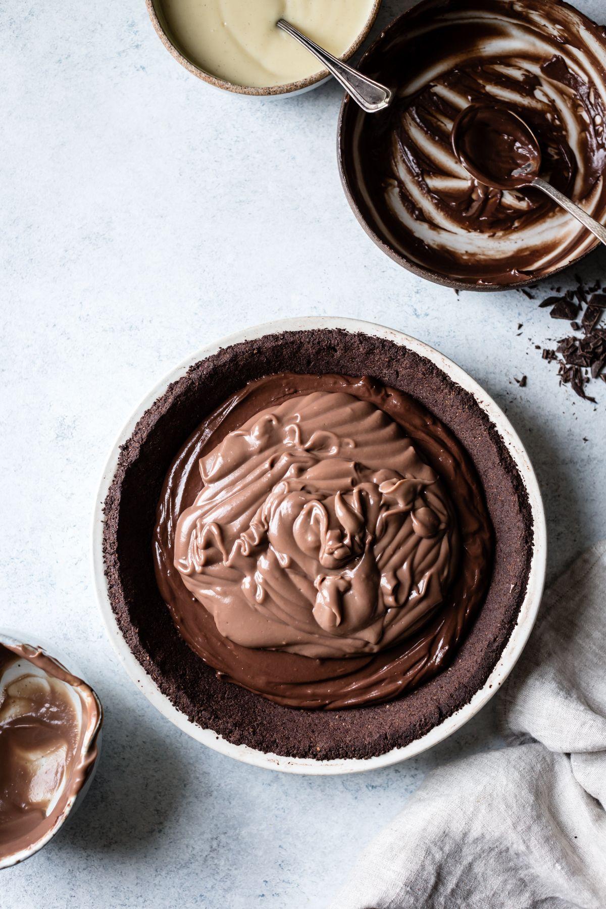 Gluten-Free Triple Chocolate Layer Pie in a Cocoa-Hazelnut Crust