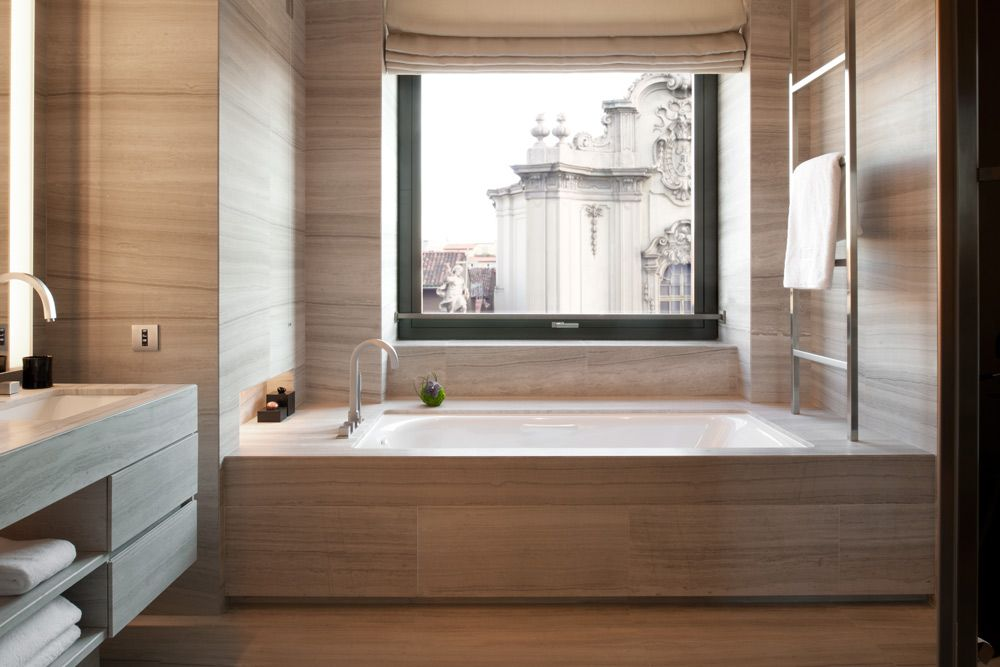 Soaking bathtub with a large picture window