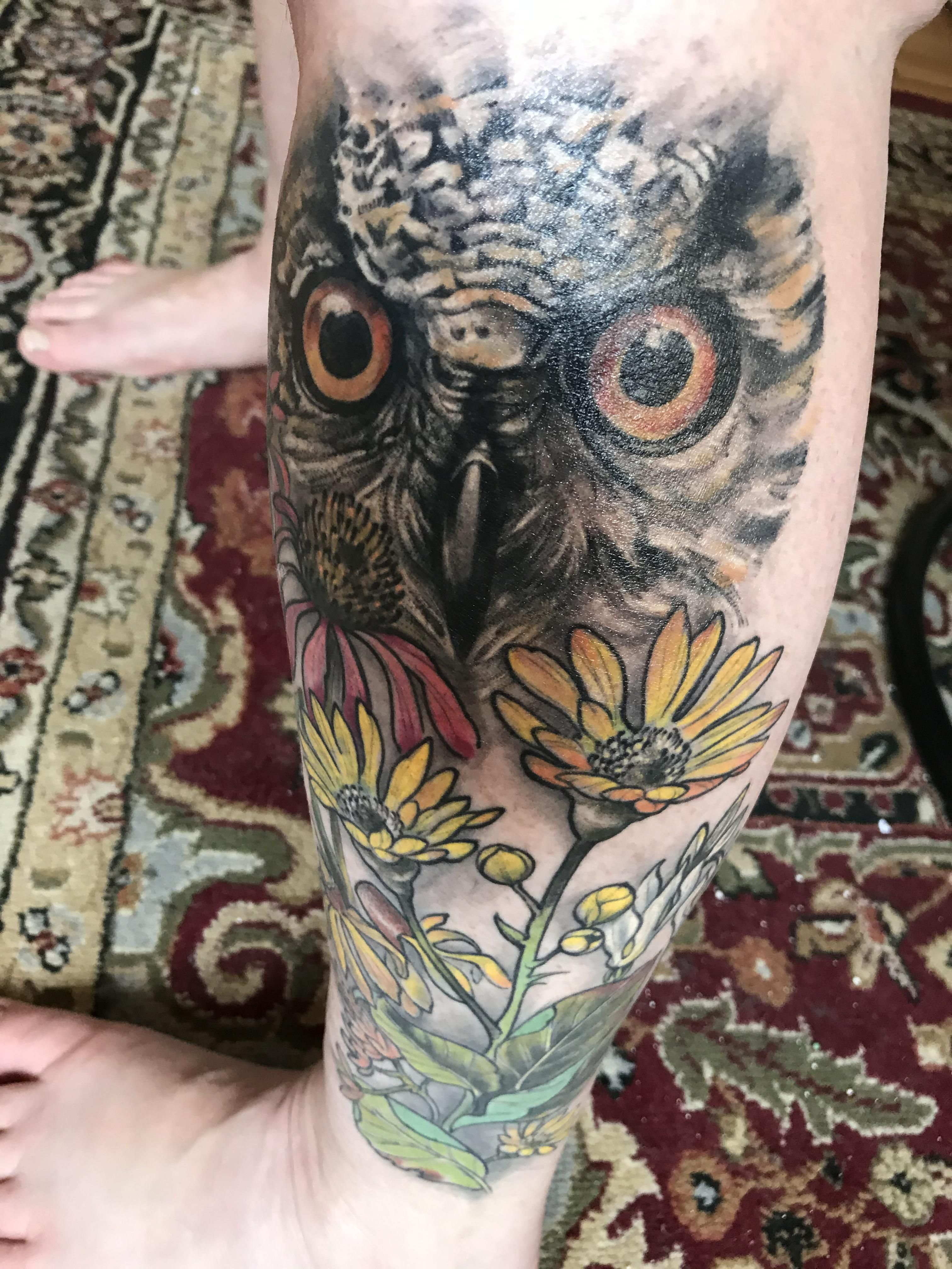 9 months healed owl with prairie flowers by Michael Tofano
