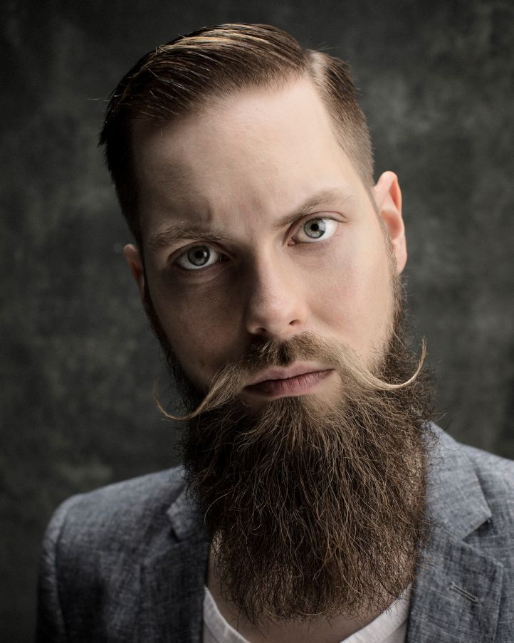 Portrait. Serious. Beard. Moustache. Photo by Riitta Supperi.