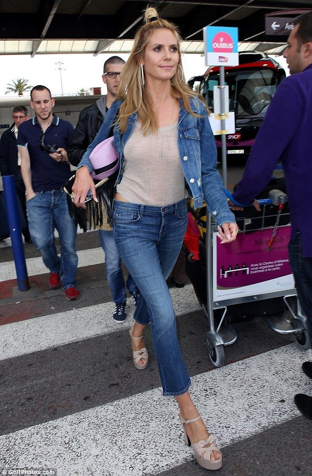 8ad5a006fd6 Raunchy runway  Heidi Klum left little of her famous assets to the  imagination as she went braless while strolling through Nice Airport on  Friday