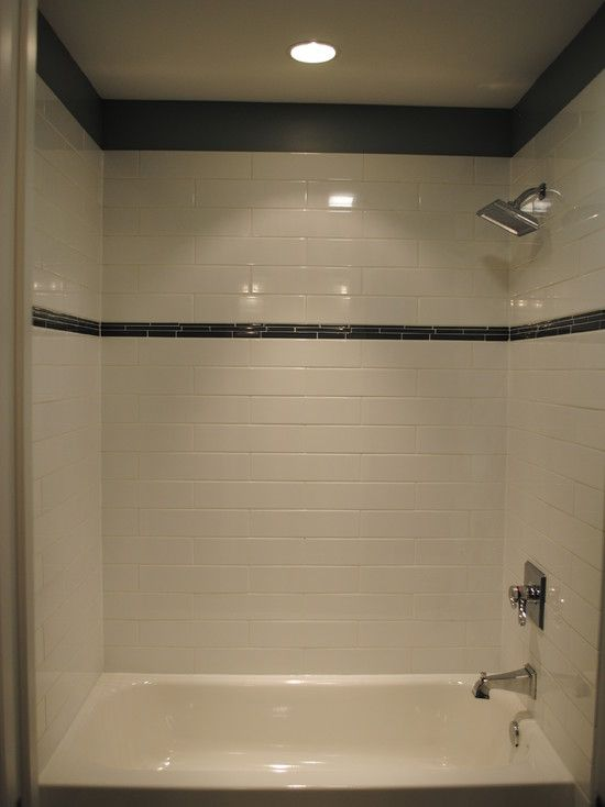 hall bathroom white tile with eye level charcoal multi frosted glass accents and a solid