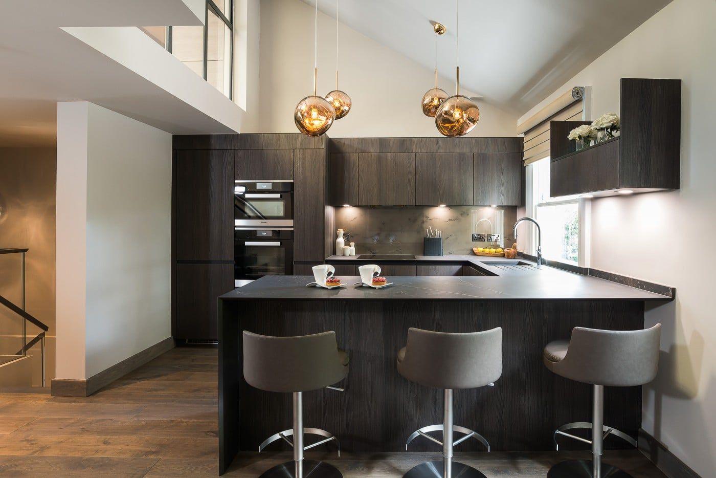 Stylish ushape kitchen in a London mews house by Elan
