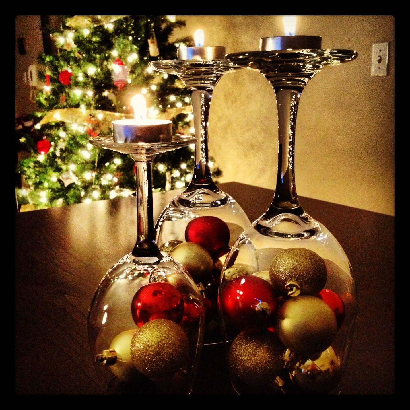 Wine glasses, tea lights, and ornaments from the dollar store, total cost $5..great holiday decoration!