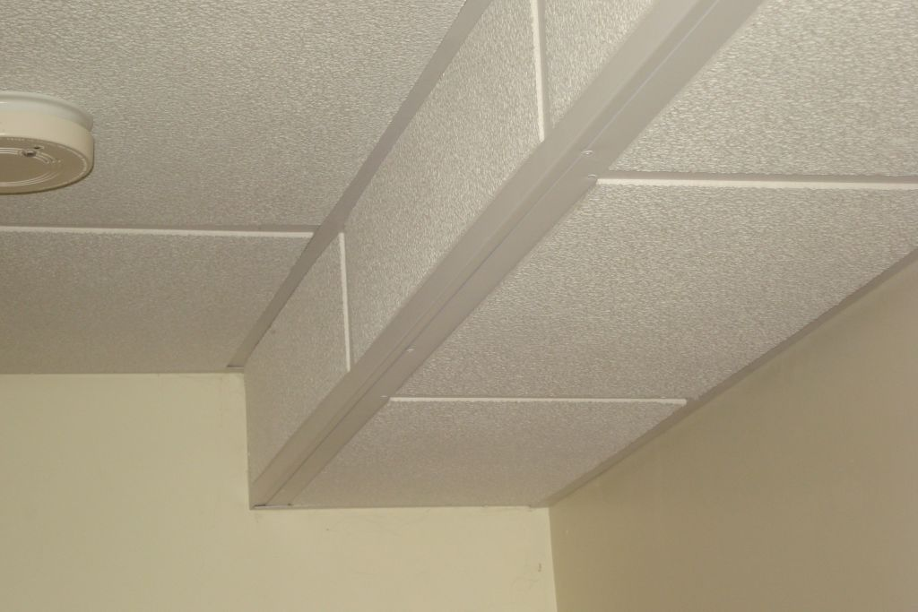 Drop Ceilings For Basements We Can Hide It By Building A Box Using The Ceiling Grid And Tile Or Ceiling Tiles Basement Dropped Ceiling Basement Ceiling
